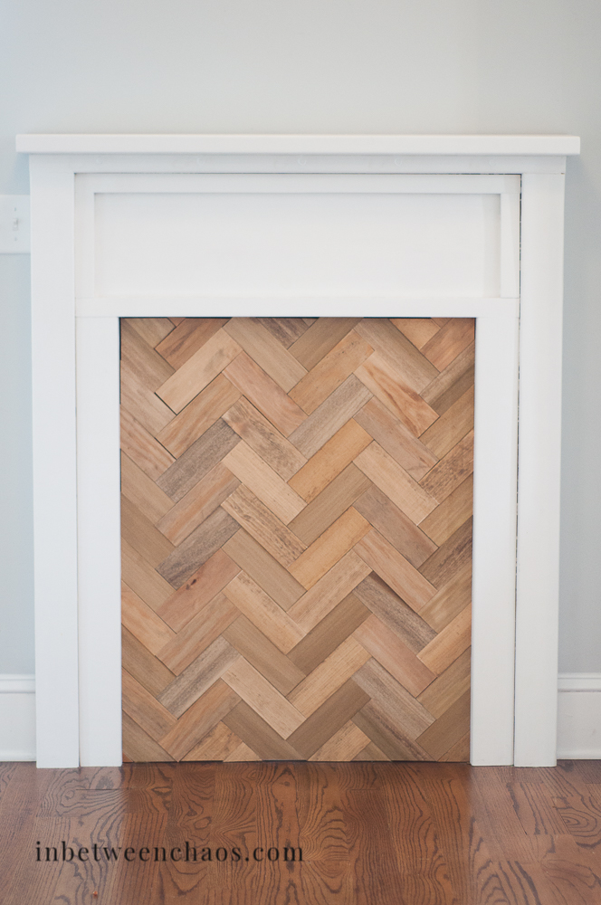 DIY Faux Fireplace with Herringbone Insert | inbetweenchaos.com